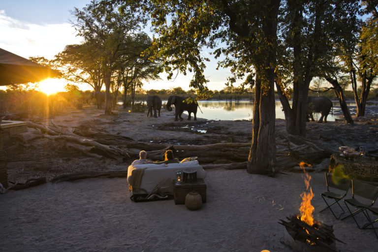 Hyena Pan's firepit and seating area is in an idela location to watch the elephants in the water at dusk with sundowners in hand