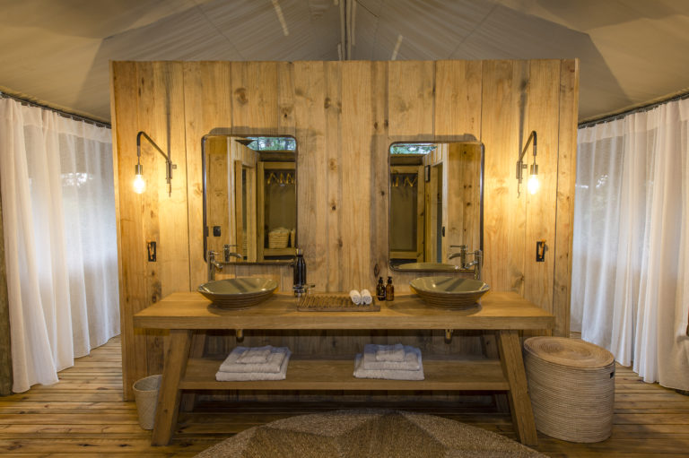 Twin basins with wooden themed en suite bathrooms at Sable Alley
