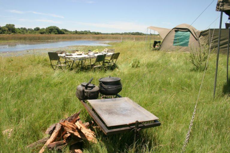 Setting up camp along the river with Bush Ways Safaris