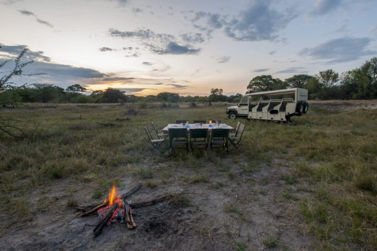 Bushways camp fire after an afternoon game drive in preparation for dinner