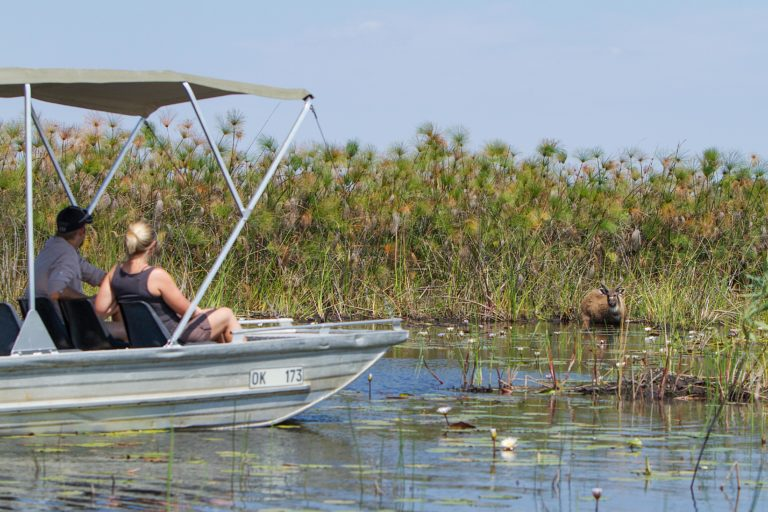 A boating safari from Camp Okavango is a great adventure