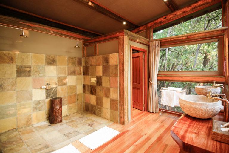 Camp Okavango guest suite bathrooms have double vanities and showers