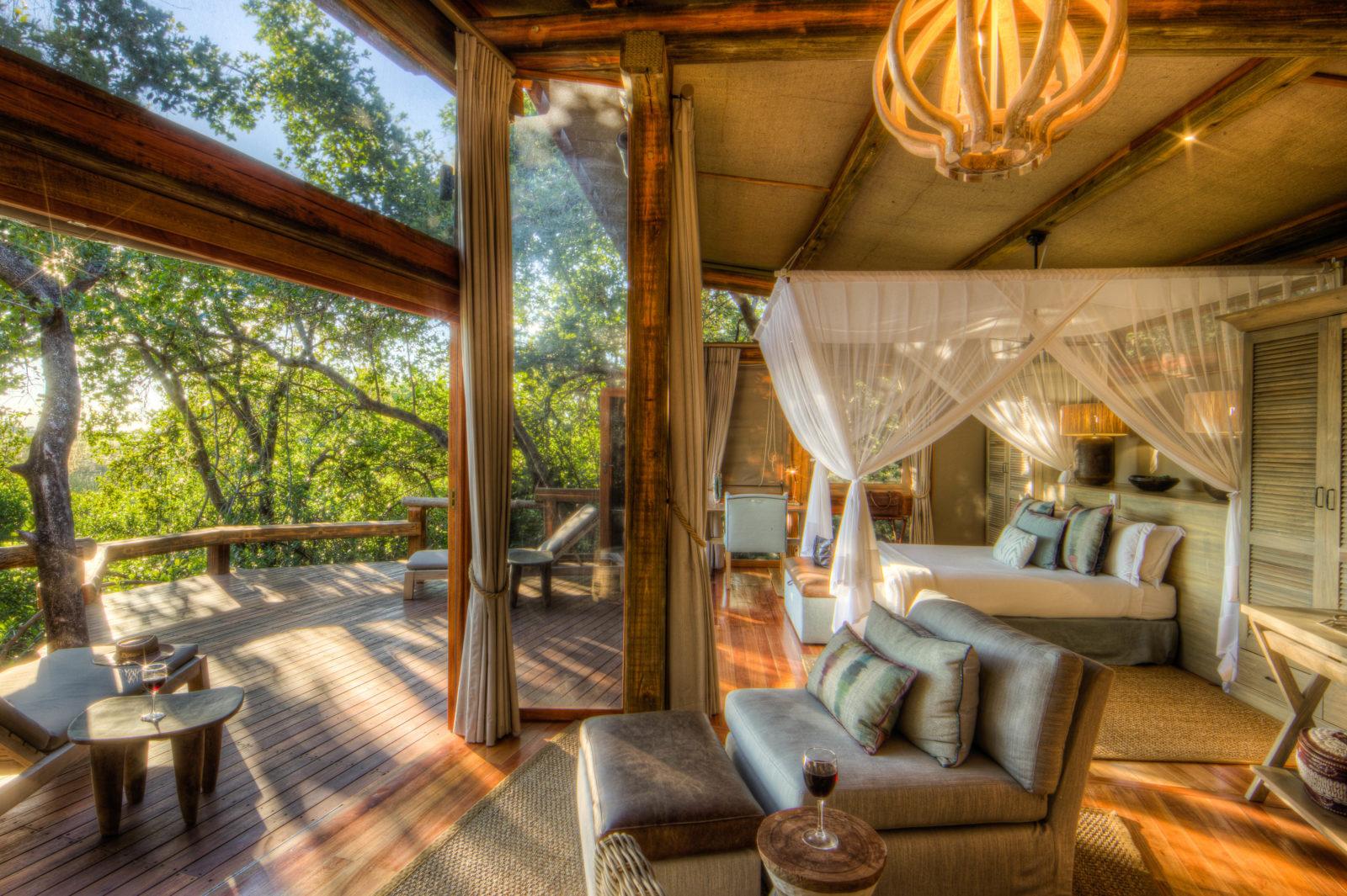 Interior bedroom and lounge space of Camp Okavango guest tent