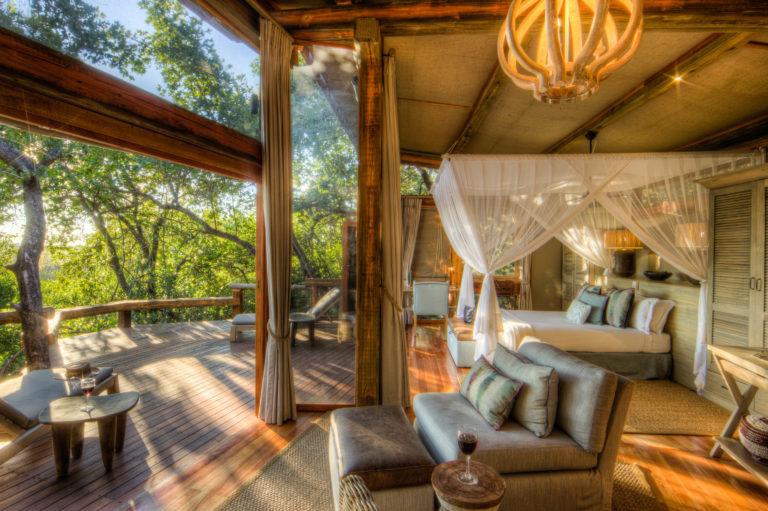 Interior bedroom and lounge space of Camp Okavango guest ten