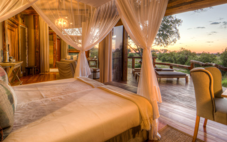 Delta view and private deck seen from inside Camp Okavango tent