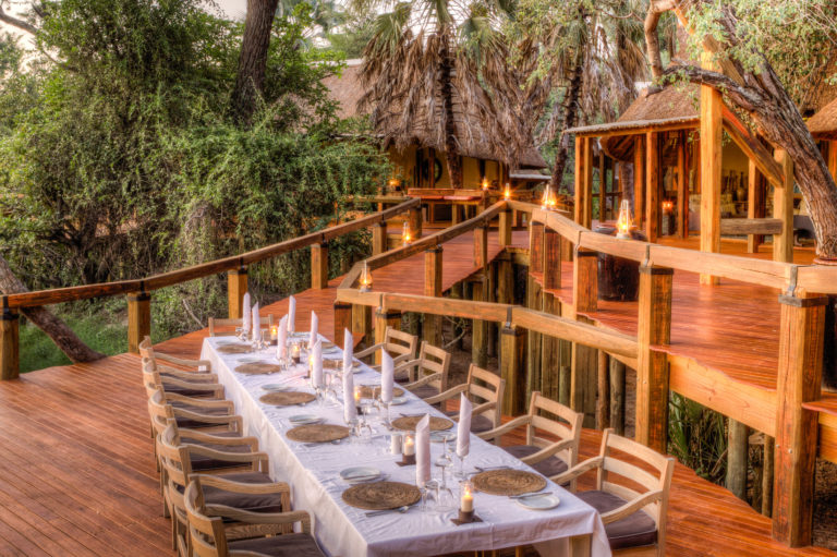 Dining outdoors on the deck at Camp Okavango