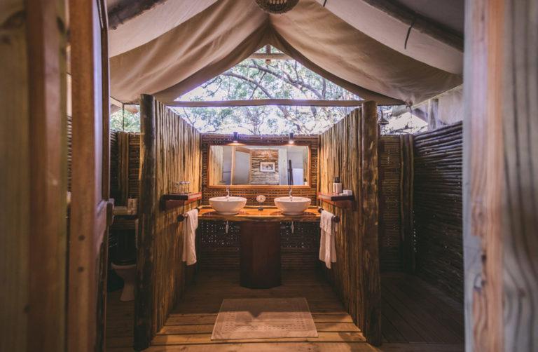 Twin basins in en suite bathroom at Camp Xakanaxa