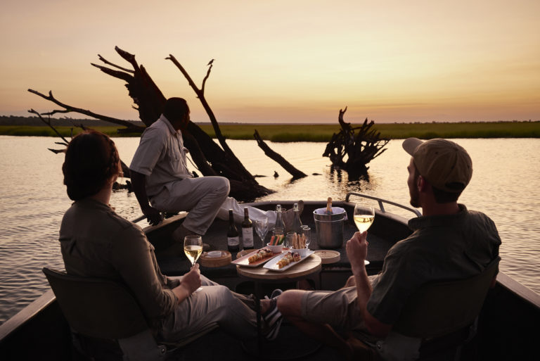 Sunset on the water on boating excursion from Chobe Chilwero