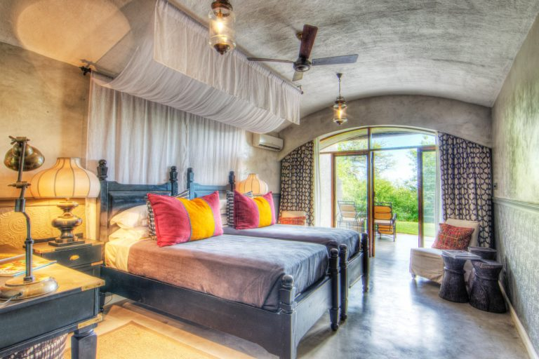 Colourful guest room interior at Chobe Game Lodge
