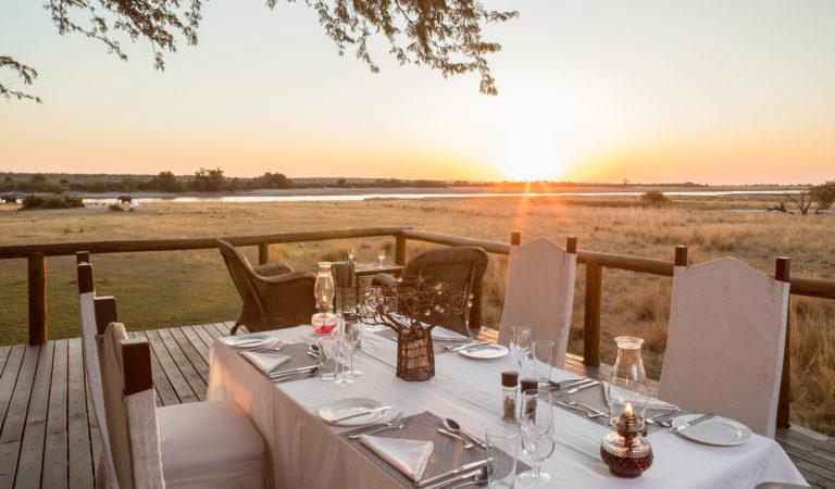 Dining on the deck at sundown at Chobe Savanna Lodge
