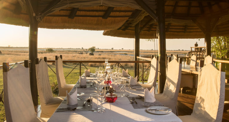 Dinner table with sweeping vistas of the landscape at Chobe Savanna