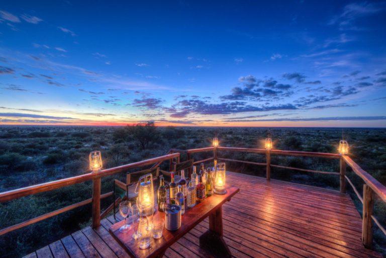 Studying the Kalahari landscape from lantern lit viewing deck at Dinaka