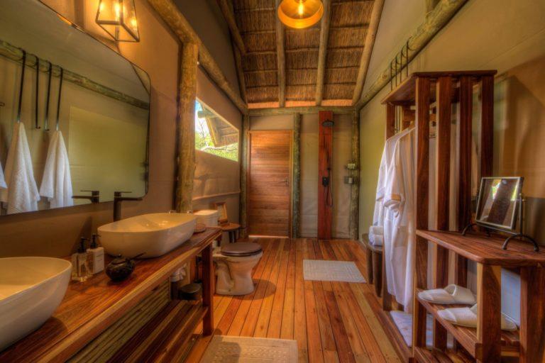 En suite bathrooms at Dinaka boast both indoor and outdoor showers