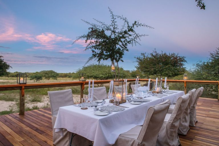 Dining on the deck with view at Dinaka Camp
