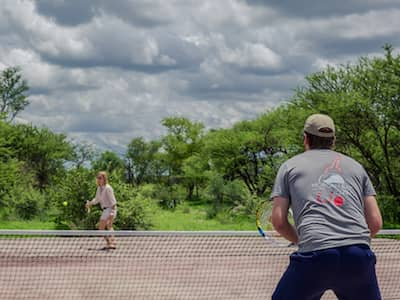 A game of tennis at Feline Fields Kalahari Lodge