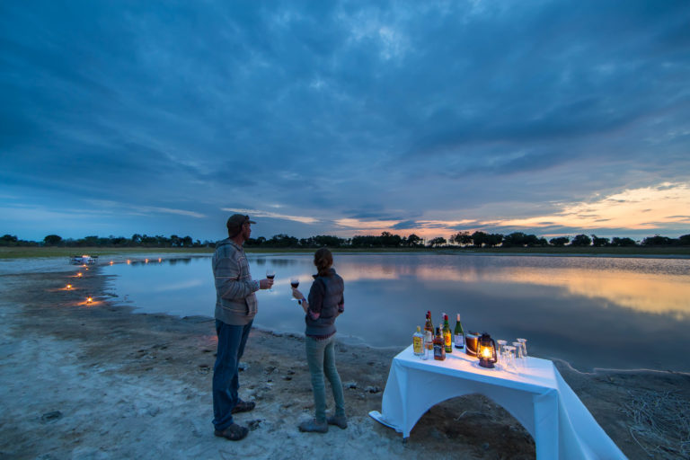 Sunset dinner at the water's edge at Footsteps Camp