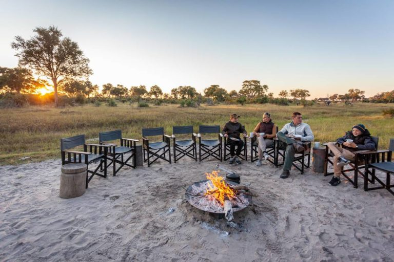 Guests enjoy the open space seated around Gomoti's fire pit