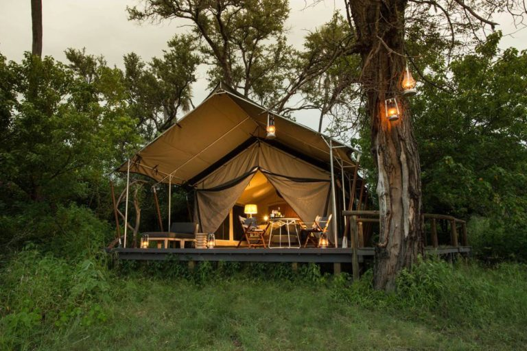 Exterior view of Gomoti Plains Tent by lantern ligh