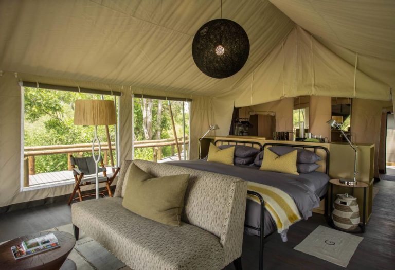 Luxury guest tent interior at Gomoti Plains Camp