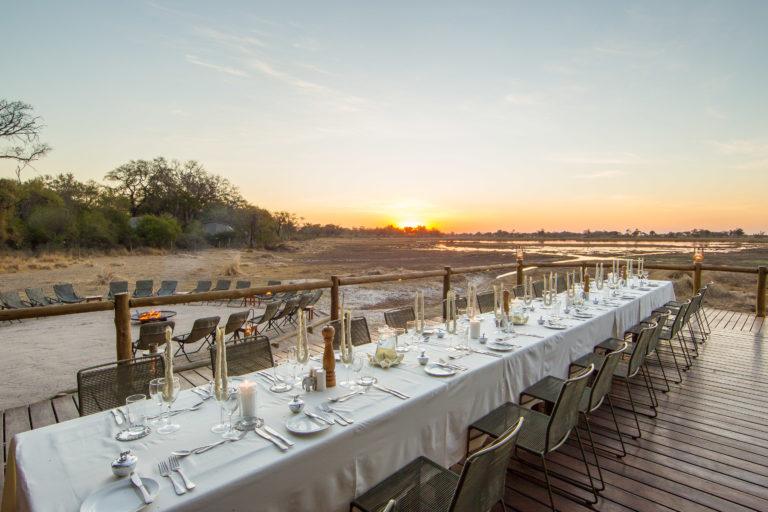 Table set for al fresco evening dining at Kanana Camp