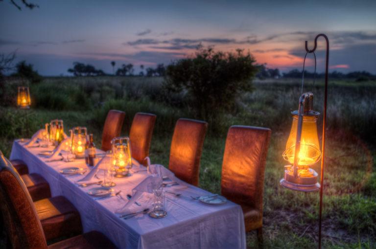 Surprise bush dinner setup for guests at Kanana Camp