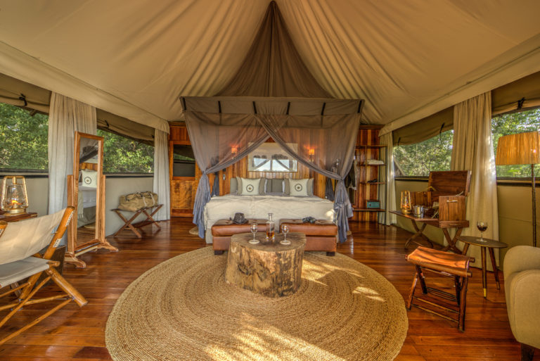 The spacious classically designed interior of guest tent at Kanana Camp