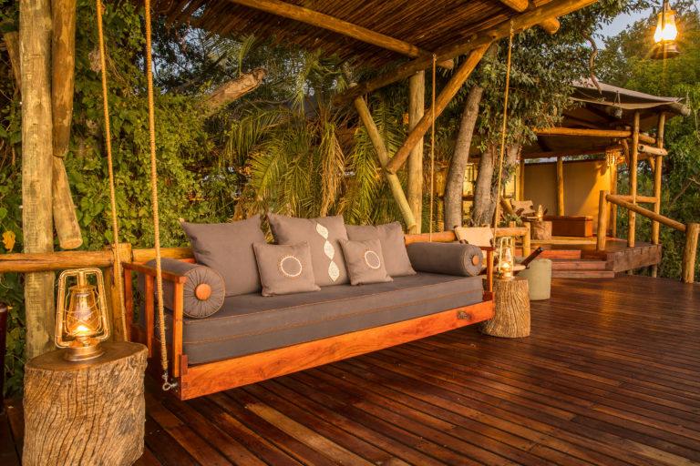 Stylish swing sofa on the deck at Kanana Camp