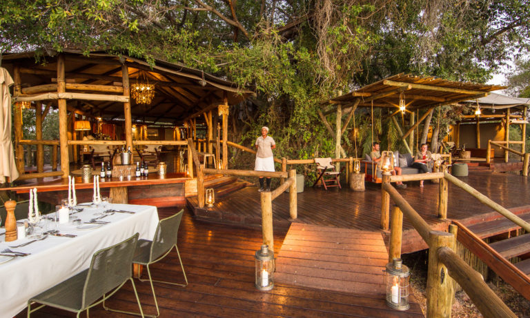 Outdoor deck and dining experience at Kanana Camp