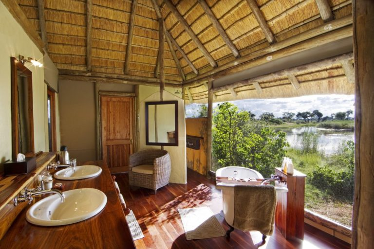 The guest bathrooms have views onto the bush
