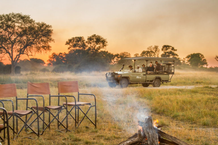 A game drive returning to the camp fire at Lebala Camp