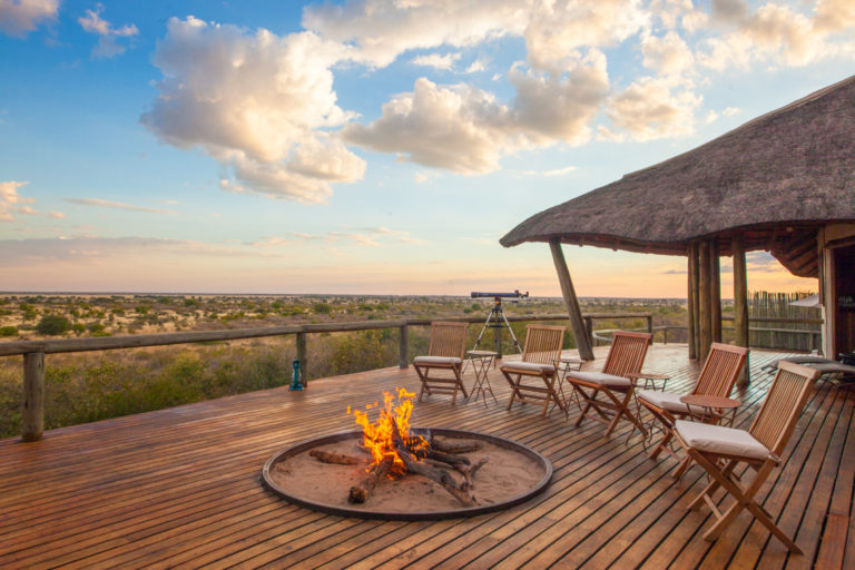 Tau Pan main deck camp fire against a spectacular Kalahari backdrop