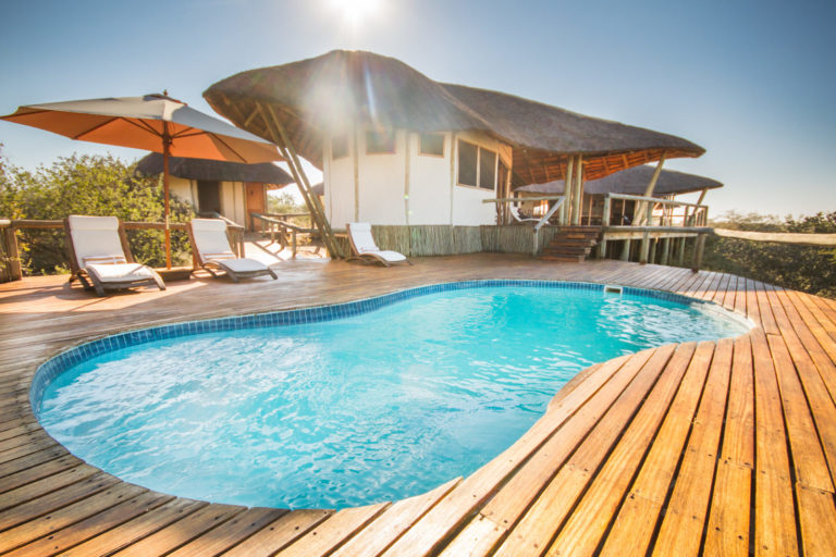 The sparkling swimming pool and wooden deck at Tau Pan Camp
