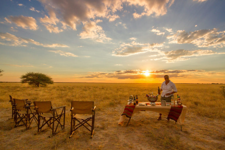 Sunset is always accompanied by refreshments after your Tau Pan game drive
