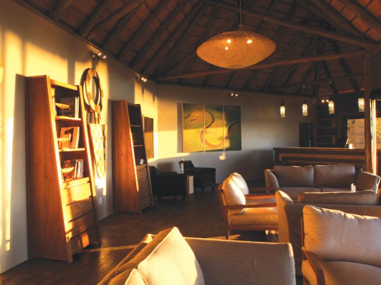 Light filters into Shakawe's lounge area overlooking the Okavango River