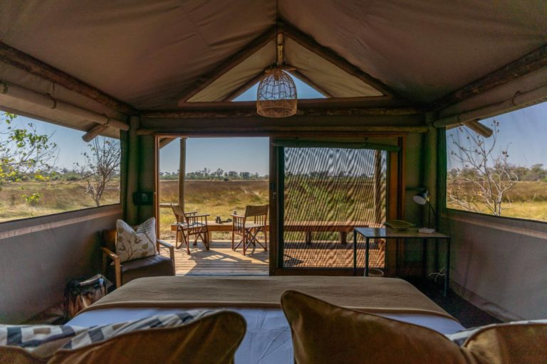 The guest tents look over the pretty grasslands of the Okavango