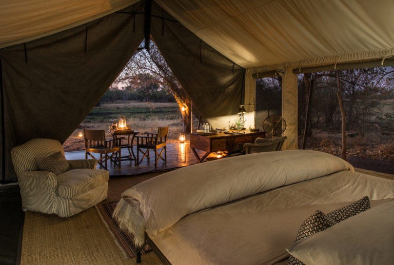 Spacious interior and natural coloured decor of Machaba guest tent