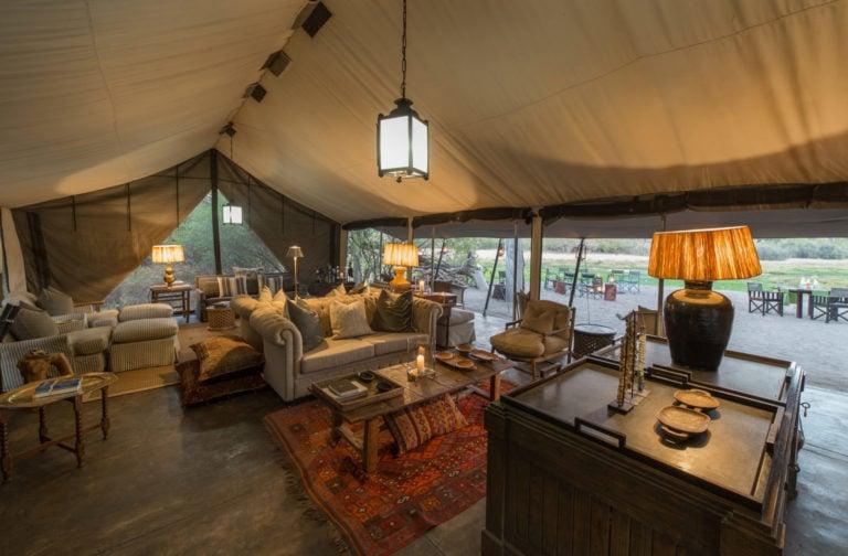 Classic Safari styled lounge interior with furnishings at Machaba Camp