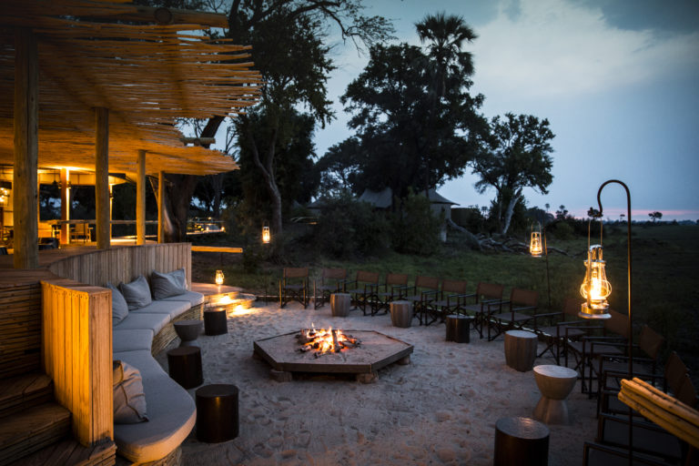Mombo's central fire pit hosts guests for sundowners and after dinner drinks