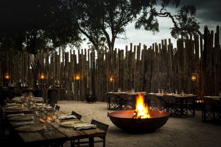 A Mombo traditional boma dinner awaits guests returning from safari
