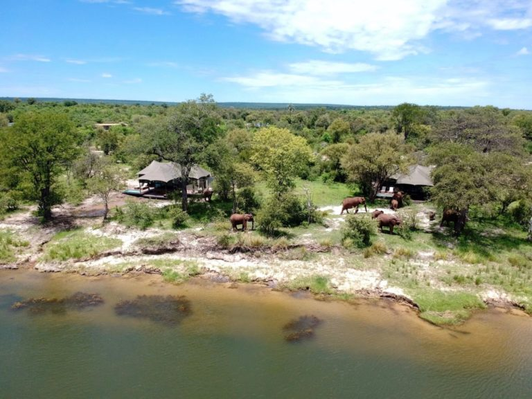 View of Old Drift Lodge next to the river from above