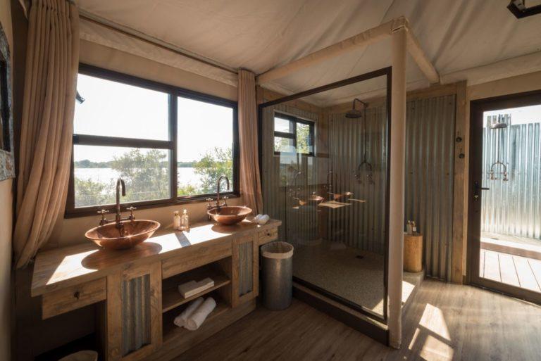 Peek into the luxury en suite bathroom at Old Drift Lodge