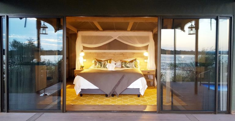 King size beds welcome you in Old Drift Lodge's luxury room