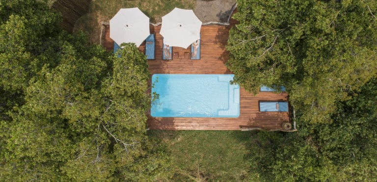 The swimming pool is perfect spot to relax between activities at Shinde Camp