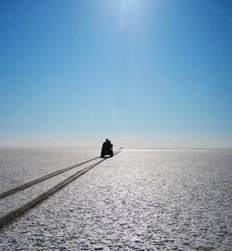 Into the stark distance on quad bike from Camp Kalahari