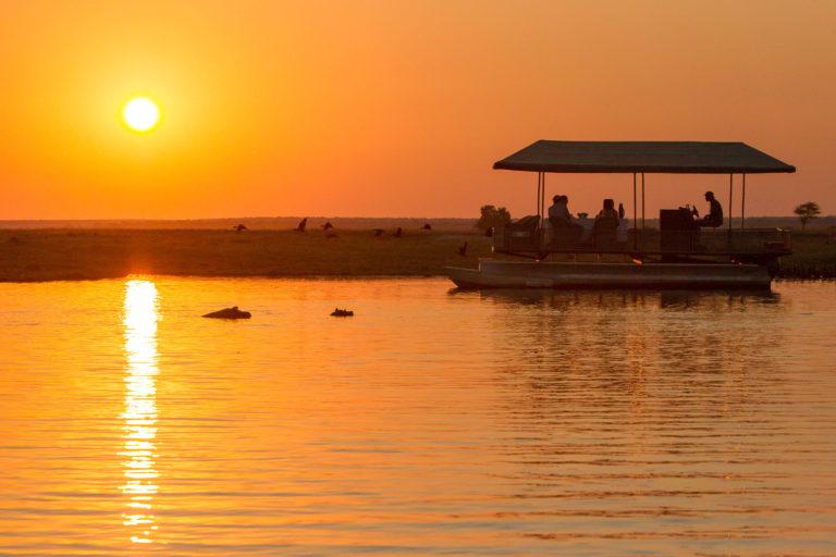 Dusk over a boating safari in the Chobe River