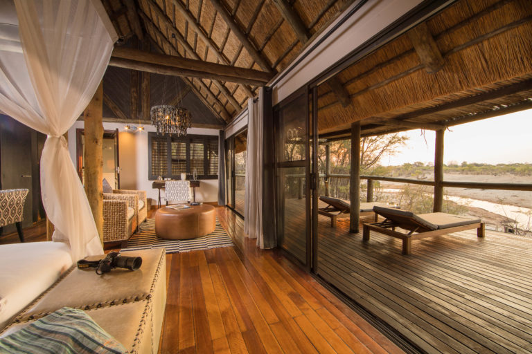 The large thatched Savute chalets are built from local timber