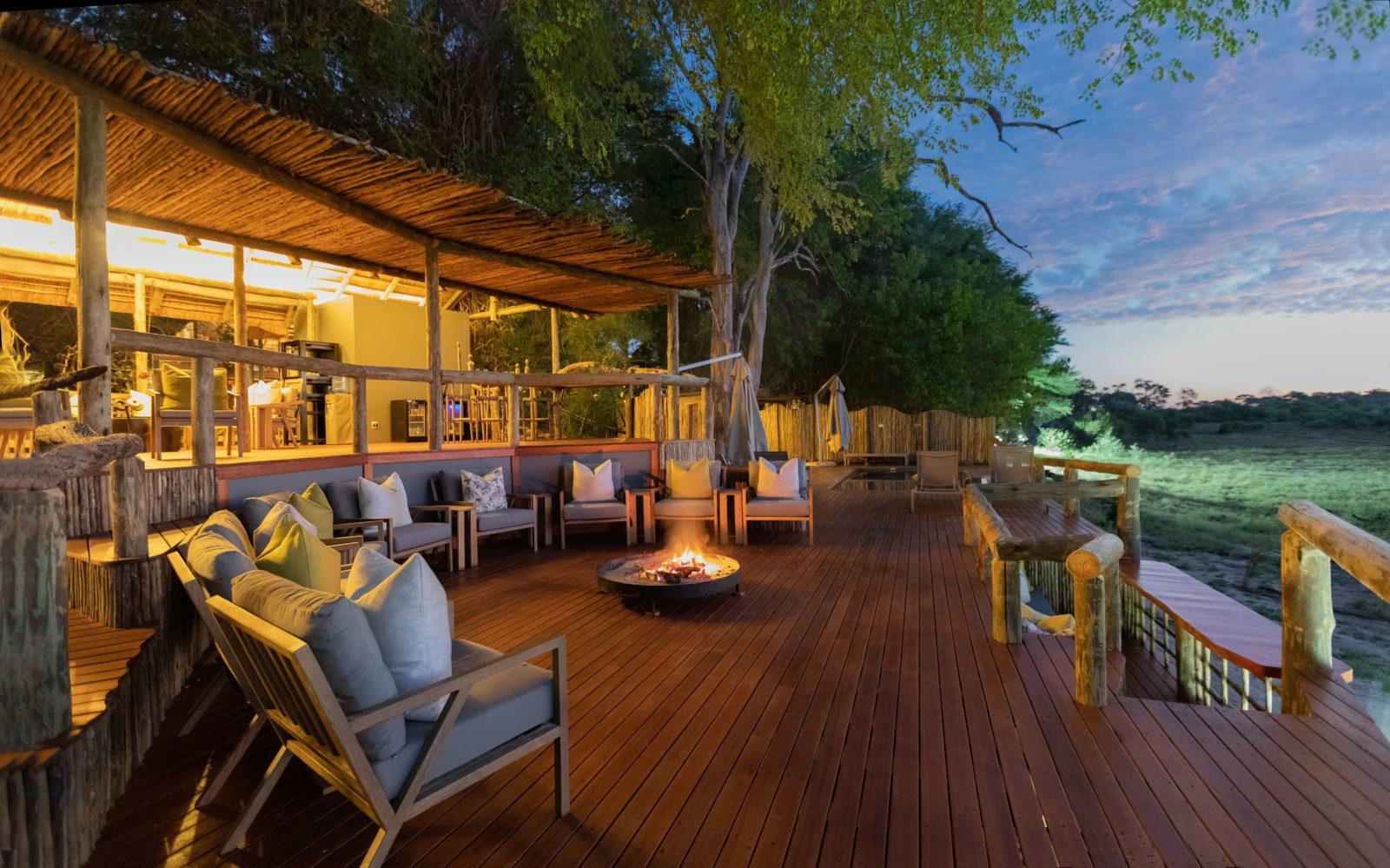 Fire deck focal point at sunrise at Savute Safari Lodge