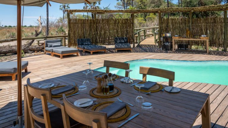 Lunch table setting at the shaded pool area at Seba Camp