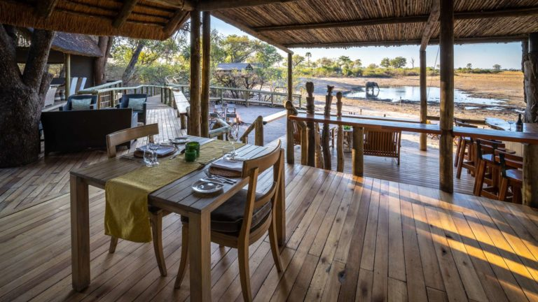 Dining with a view over a waterhole at Seba Camp