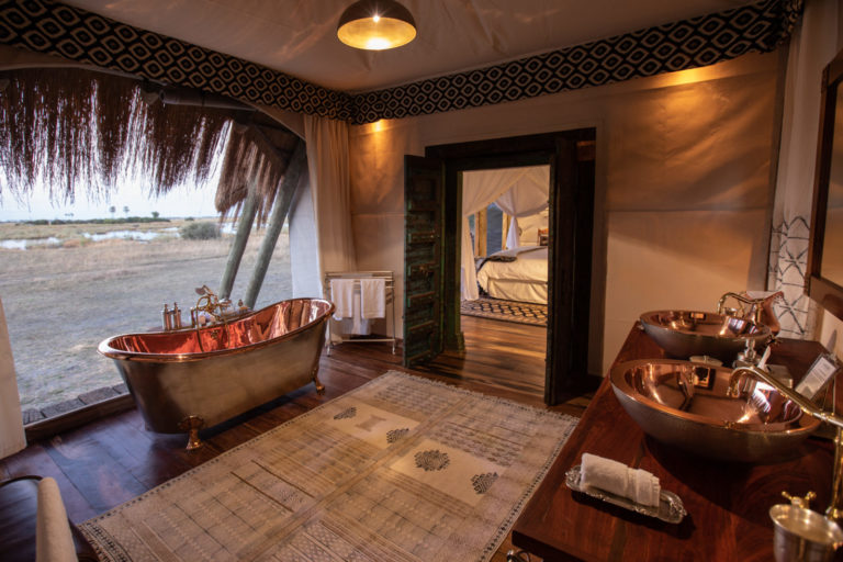 The African themed ensuite bathroom with copper bath at Selinda